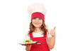 happy little girl cook with salmon and thumb up