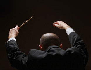 Concert conductorwith a baton