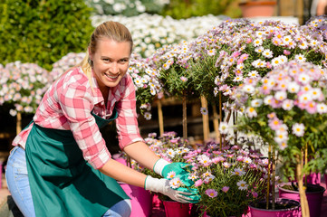 Garden center woman daisy potted flowers smiling