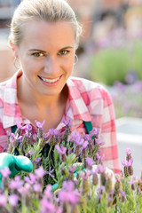 Smiling woman with purple flower garden center