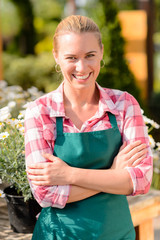 Garden center smiling woman worker wear apron