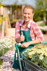 Garden center smiling woman flowers thumb up