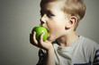 Child eating apple.Little Boy green apple.Health food.Fruits