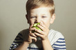 Funny Child eating apple.Little Boy.Health food.Enjoy Meal