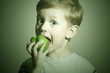 vitamin.Child eating apple.Little Boy.Health food. Fruits
