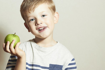 Smiling Child with apple.Little Boy.Health food.Fruits