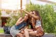 Three beautiful woman eating ice cream during selfie doing photo