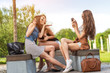 Three beautiful woman eating ice cream during selfie doing photo