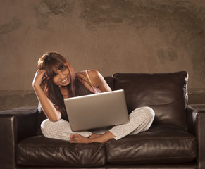 Young attractive girl woman sitting on the couch