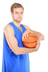 Young basketball pro holding a ball