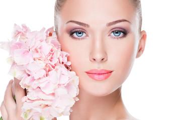 Closeup face of young beautiful woman with a pink makeup of eyes