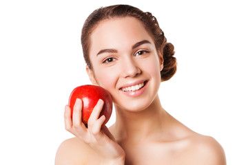 Smiling beautiful woman holding red apple while isolated on