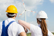 Engineers or installers looking at wind energy turbine