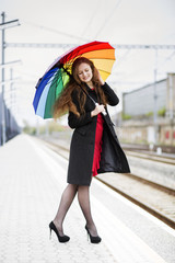 Woman with umbrella look at feet