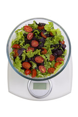 Diet. Vegetables salad in a bowl with weight scale, isolated on