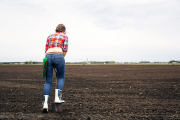 Woman standing on force shovel to ground