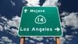 Mojave Desert Freeway Sign to Los Angeles with Time Lapse Clouds