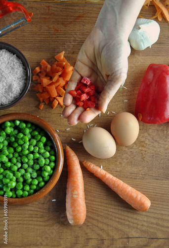 hand cutting vegetables for cooking