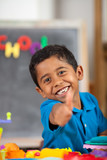 Fototapety Happy Hispanic Child in School Setting Giving Thumb Up