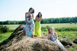 Young beautiful women on hay