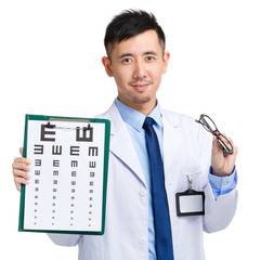 Doctor with eye chart and hold glasses