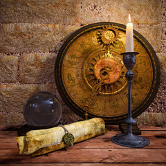 concept still life with zodiac sighs and candle