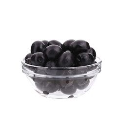 Glass bowl with black olives.