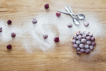 Raspberry tart on wooden background
