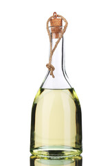Small bottle of olive oil with cork stopper.