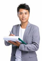 Business man write on clipboard
