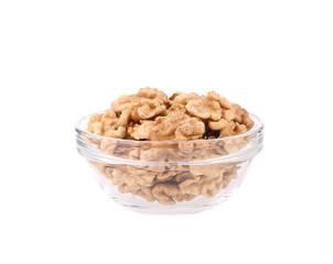 Glass bowl with walnuts.