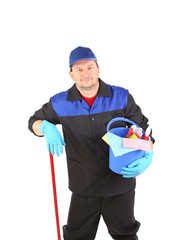 Worker with cleaning equipment.