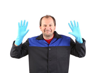 Man in workwear showing palms.