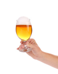 Hand with glass of beer.