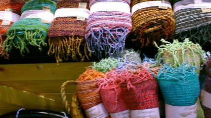 The colored rolled scarves in rows at market. Video shift motion