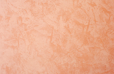 Cement wall background, orange colored.