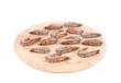 Raw shrimp on wooden platter.