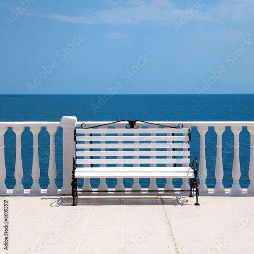 Fototapeta white bench and balustrade overlooking the sea