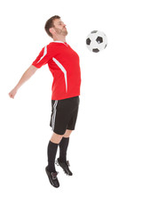 Player Hitting Soccer Ball With Chest