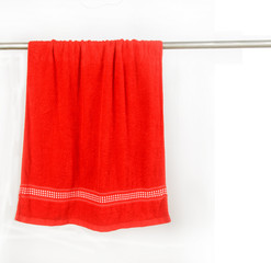 red towel hang on rack with clip