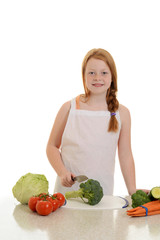girl cutting broccoli