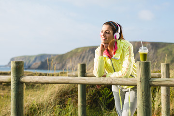 Pensive fitness woman relaxing after workout