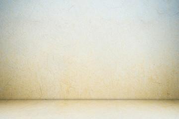 Empty cement room in perspective.