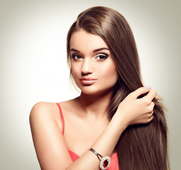 portrait of beautiful young woman with long healthy brown hair.