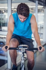 Focused fit man on the spin bike