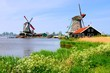 Windmills along a canal at Zaanse Schans, Netherlands