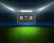Football pitch with scoreboard and lights