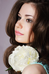 Tender Daydreaming Girl with White Peony Closeup