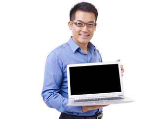 asian businessman with laptop, isolated on white background