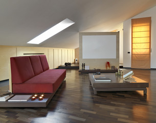 red fabric sofa in a modern living room in the panthouse